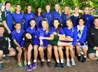 EXCITING FUTURES: St Peter Claver College's successful under-18 girls football team, flanked by coach Greg Farrell (right) and manager Dallas Murphy.