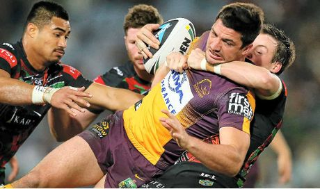 Matt Gillett of the Broncos is tackled by South Sydney Rabbitohs players at ANZ Stadium in Sydney last night.