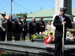 Long Tan Servicemen stand with hand over their hearts after laying wreaths at Hervey Bay Cenotaph during Vietnam Veterans Commemoration Service.Pictured also are two young friends who helped lay the wreaths. Photo: Robyne Cuerel / Fraser Coast Chronicle