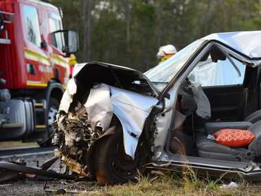 DOUBLE FATAL: Emergency services attend the scene of a crash on the Isis Highway in which two people died. The crash occured early on 21 August, 2014 when two vehicles collided head on.