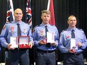 GYMPIE firefighters Grant Feeney and Tony Wildman were awarded for a fearless rescue mission in Widgee Creek during the January 2013 floods.
