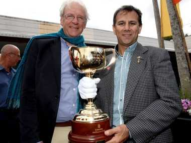 Tweed Shire Mayor Barry Longland and 1999 Melbourne Cup winning jockey John Marshall, with the Melbourne Cup in Murwillumbah.