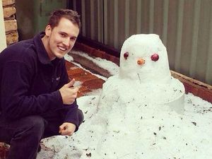 Jamie Phillip Skinner makes a 'snow man' using the hail that blanketed Toowoomba yesterday.