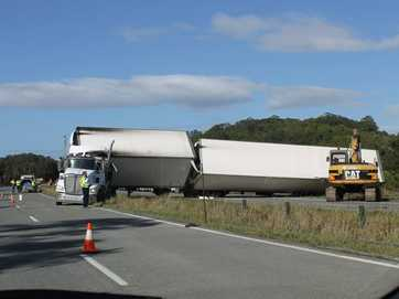 A truck rollover on the Pacific Highway at Chinderah has left a 12km-long traffic jam of trucks backed up all the way to the Cabarita turn-off.
