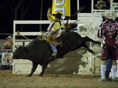 HOLD ON: Mick Ford on Hard Edges at the Tuff Bullbars Australian All Star Challenge Professional Bull Riders Australia event in Toowoomba last year.