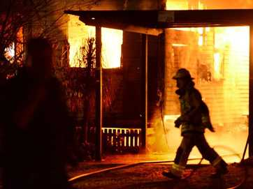 Fire fighters tackle a blaze at a house on Chubb Street in One Mile early Monday morning.