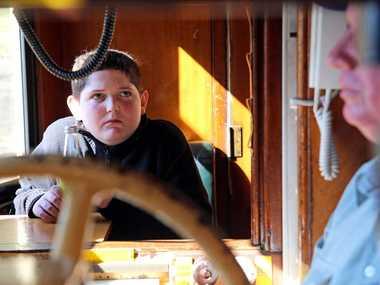 Bray Atkin watches driver Rod Short during an historic train trip on Sunday. Photo Gemima Harvey/ Coffs Coast Advocate