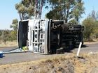 A 55-YEAR-OLD truck driver crawled out of the wreckage of his vehicle after it rolled on Jackson-Wandoan Rd this morning.