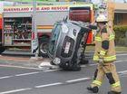 Car flips in two-vehicle crash at Urangan