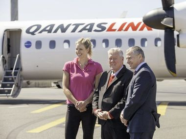 Wellcamp Airport ambassador Laura Geitz, Wagners chairman John Wagner and QantasLink CEO John Gissing land at Brisbane Airport ahead of the announcement QantasLink would be opening regular passenger services at Wellcamp Airport.