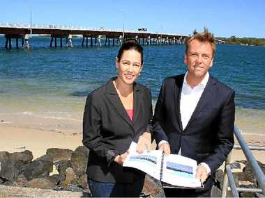 WAIT AND SEE: Member for Pumicestone Lisa France and Transport and Main Roads Minister Scott Emerson look over plans for a new Bribie Island Bridge.