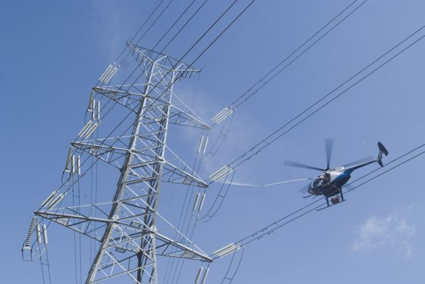 High Voltage Transmission Lines : Low flying helicopters will clean high voltage power lines