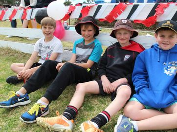 Beau Bannon, Kobi Jones, Jack Lewis and Lachlan McNichol cheer on their fellow United team mates at the grand finals on Saturday. Photo Erin Smith / Stanthorpe Border Post