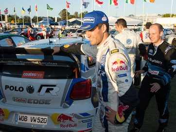 2014 WRC coasteshire rally winner, Volkswagen's Sebastien Ogier celebrates with the rest of the Volkswagen Team.