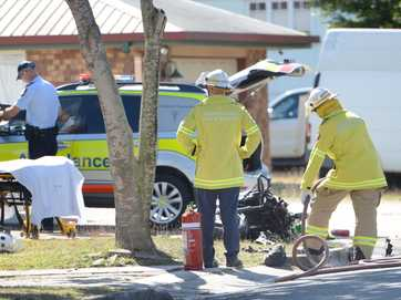 Emergency Services respond to an accident near the corner of Charles and Musgrave Streets involving a car and a motorcycle where the motorcyclist received serious burns.