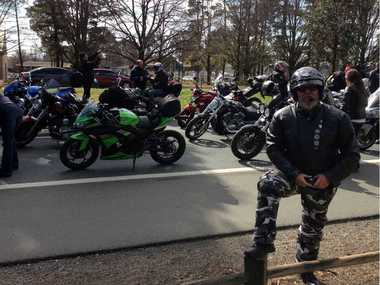 WALL TO WALL: Snr Const Terry Parker on the road as part of the ride.