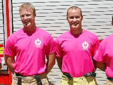 """THINK PINK: Queensland Fire and Emergency Services Airlie Beach branch senior firefighter David Thomas, firefighters Nick Bellinger, Blair Mitchell and newly appointed station officer Kevin Tomas wore """"real firies wear pink"""" t-shirts for a good cause."""
