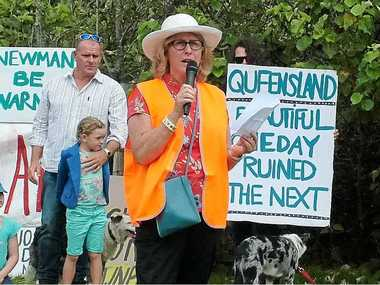 NO WAY: Julie Failor of Development Watch gives a passionate address about what is special about Yaroomba at the protest rally.