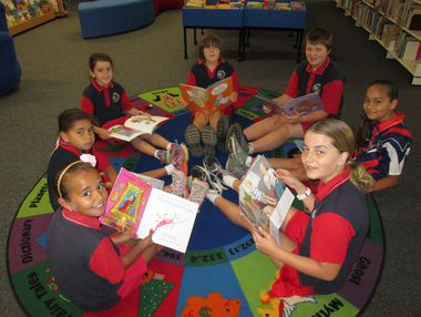 The children at Alligator Creek State School connect with friends and reading in their school library for Book Week 2014. PHOTO: Contributed