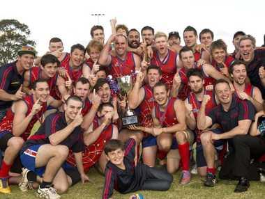 The Warwick Redbacks celebrate their maiden AFL Darling Downs premiership.