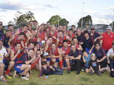 VICTORY AT LAST: The Warwick Redbacks celebrate their grand final win in the AFL Darling Downs first-division competition at the weekend.