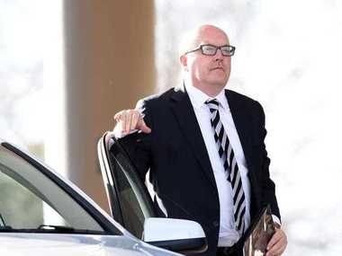 Attorney-General George Brandis arrives at the Rydges Hotel to discuss the federal government's proposed counter-terrorism laws with Islamic leaders in Parramatta, Friday, Aug. 29, 2014.