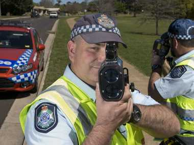 Toowoomba Road Policing Unit officers Acting Senior Sergeant Brendan Harding (left) and Senior Constable Darren Payne check the speed of motorists on Ballin Dr.