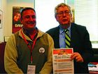 KEEP IT: Long distance driver Eric Pickering delivers the Safe Rates message to MP Laurie Ferguson.