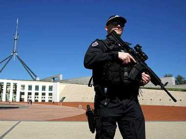 Australian Federal Police officers patrol the front of Parliament House in Canberra, Tuesday, Sept. 23, 2014. AFP has taken over Parliament House Security after 'chatter' about possible terrorist attack.