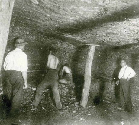 BLACKSTONE BOYS: Workmen hew coal from the Bogside Pit, Cooneana Estate, in earlier days.