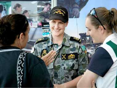 GIVE IT A GO: Petty officer Melissa Henry encourages girls to consider a career of a technical nature.
