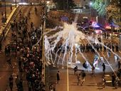 PRO-DEMOCRACY protesters in Hong Kong were reportedly met by police using tear gas and heavy force on Sunday night.