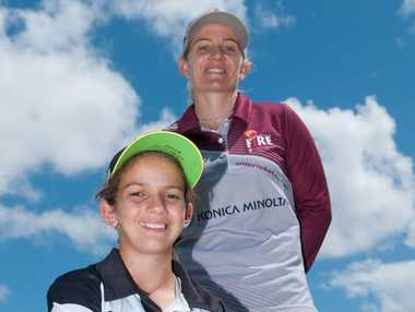 ON FIRE: Mackay junior cricketer Charli Knott, front, with Queensland Fire captain Jodie Fields who has provided a scholarship of $2000.