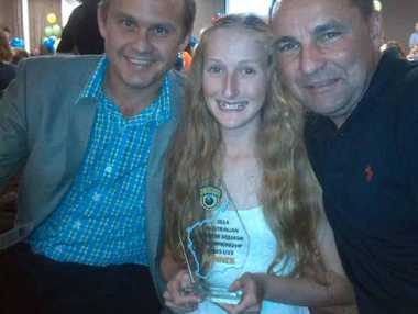 NATIONAL CHAMPION: Laura Moloney with NSW coaches Scott Butcher and Adam Schreiber.