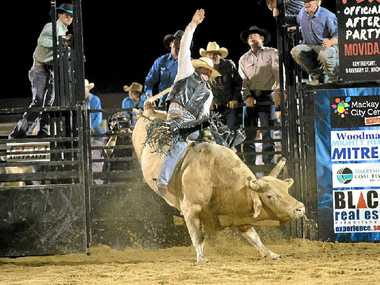 HANG ON: Bull rider Guy Ford delivers an 84-point ride on Gravelhead during the PBR Australia event in Mackay last weekend.