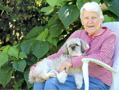 GREAT CHALLENGE: Valerie Thomas was a bush woman who raised six kids on her own way out west. She is pictured here with her dog Prince.