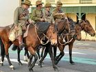AS THEY rode across the Story Bridge through smoke and lights, members of the 11th Light Horse Warwick-Montrose Troop relived a century-old moment in history.