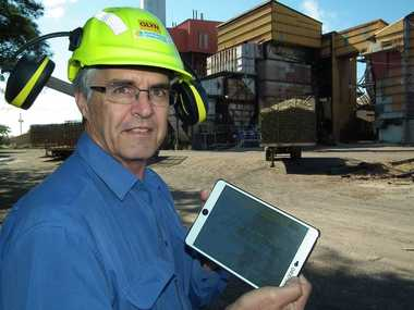 MSF Sugar's IT manager Glyn Peatey demonstrates the remote wireless technology with an iPad near the factory in Maryborough.