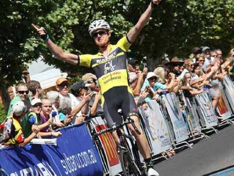 Photo: 2013 Grafton to Inverell Cycle Classic winner Jack Anderson plays up to the crowd at the finish line..