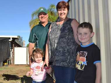 Chinchilla builder Lee Irwin recently pitched in to help the smith family, including Debbie and her children Shylah and Connor, erect their new fence.