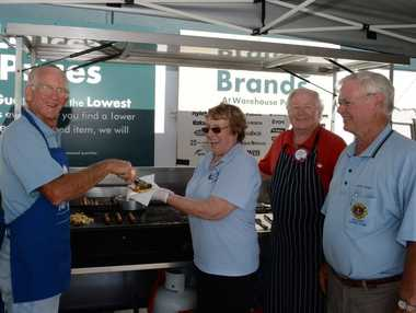 Gary Gear, Pam Dean, Jeff Spencer, and Peter Dean from the Ballina Lions Club, raising money with a sausages sizzle at Bunnings in Ballina for the Owen street fire victims. Photo : Mireille Merlet-Shaw/The Northern Star