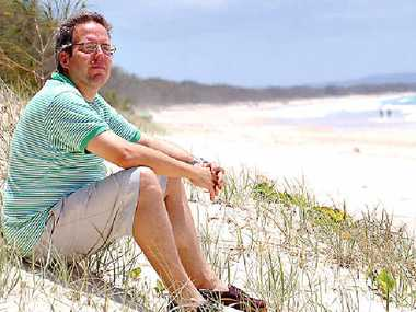 NO HAPPY ENDING: Andreas Krauchi on the beach in front of his Rainbow Shores development.