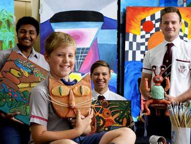 PRIZED PIECES: Ipswich Grammar School art students Timor Loban, Jayden Tucker, Maclay Kenman and Mark Broadhead display some of the artworks that will feature at the school's expo.