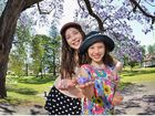 OCTOBER IN BLOOM: Enjoying the spectacular jacaranda trees in Memorial Park, which bloom each year in time for Gympie's Gold Rush celebrations, are Eva Marshall, 10, and her sister Rosalee, 7.
