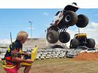 READY TO FLY: Clive Featherby watches Spot the monster truck fly high as he prepares fireworks for a massive night on Mothar Mountain on Saturday.FULL STORY PAGE 4.