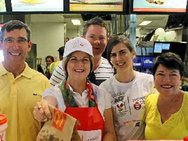 YUM: Franchise owner Michael Muller, Mayor Jennifer Whitney, business manager Russell Smith, event manager Jemma McIntyre and licensee Jane Muller celebrate McHappy Day at Cannonvale McDonald's on Saturday morning.