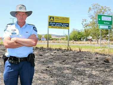 BURNING QUESTION: Senior Sergeant Jim McDonald at one of the places where a firebug caused havoc in Laidley.