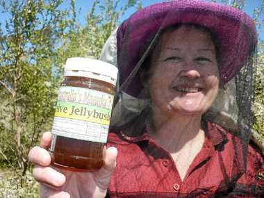 AUSTRALIA'S MANUKA: Broadwater apiarist Carmel Maloney with a jar of her family's medicinal honey.