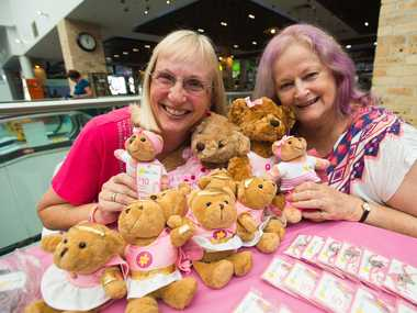 GIVING BACK: Neridah Lee and Lyn Crossley selling Pink Ribbon Day merchandise yesterday.