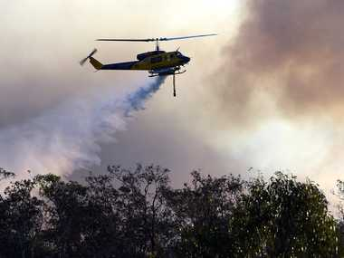 Water bombing helicopters battle the bushfire burning near Bestmann Rd, Ningi, on Saturday, October 25, 2014. Photo Jorge Branco / Caboolture News